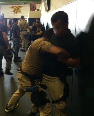 Two men learning defense