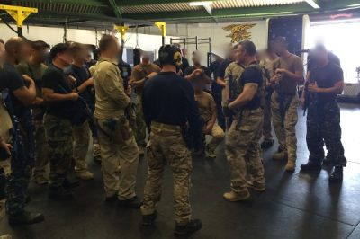 Multiple people standing learning tactical defense